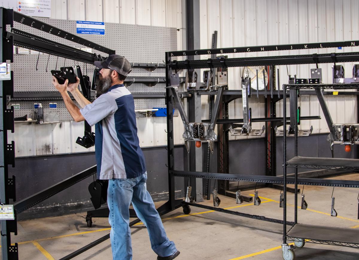 A man racking equipment pieces.